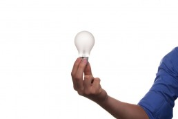 man holding lightbulb