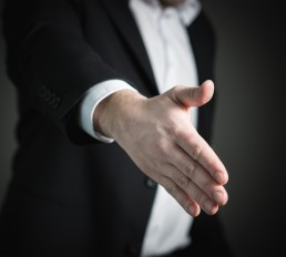 businessman reach out his right hand to shake
