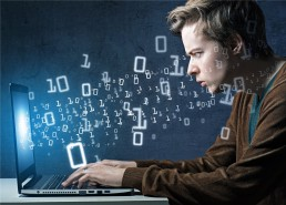 Man at laptop with binary codes
