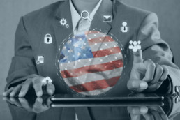 man with tablet using modern technological interface USA flag